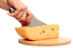 Cutting cheese Stock Image