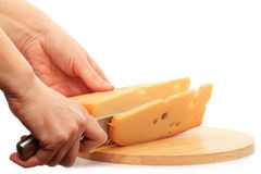 Cutting cheese Stock Photography