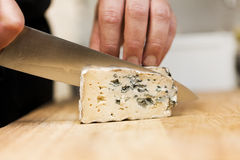 Cutting cheese Stock Images