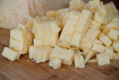 Cutting cheese - food ingredients Royalty Free Stock Image