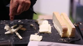 Cutting cheese stock footage