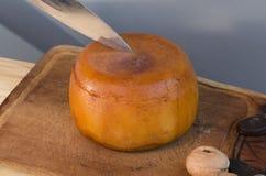 Cutting a Cheese wheel Stock Photo
