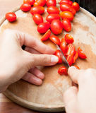 Cutting cherry tomatoes Royalty Free Stock Image