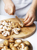 Cutting the chestnut mushrooms into thin slice Stock Photos