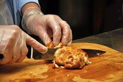 Cutting the chicken