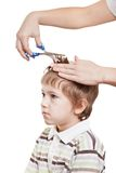 Cutting child hair Royalty Free Stock Photography