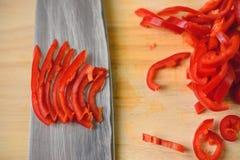 Cutting chili pepper Royalty Free Stock Photo