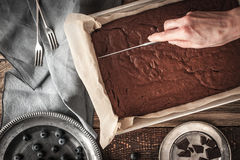 Cutting chocolate brownie horizontal Royalty Free Stock Photo
