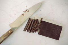Cutting a chocolate Stock Photo