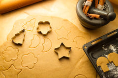 Cutting Christmas cookies Royalty Free Stock Images