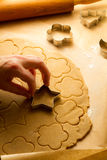 Cutting of Christmas cookies Stock Images