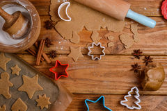 Cutting Christmas cookies on table. Cutting Christmas cookies on wooden table Royalty Free Stock Images