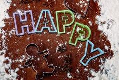 Cutting christmas gingerbread cookies Stock Photos