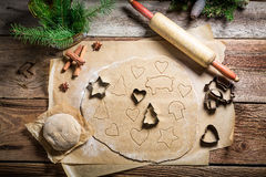 Cutting Christmas gingerbread cookies Stock Photography