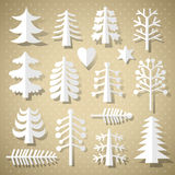Cutting Christmas trees of white paper Royalty Free Stock Image