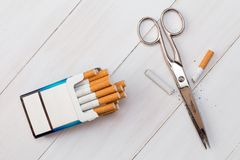 Cutting cigarette by scissors. Anti smoking or quit smoking concept Stock Photography