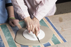 Cutting the clay to shape Stock Photography