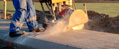 Cutting concrete stock images