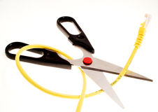 Cutting the connection. A pair of scissors about to cut a lan internet cable royalty free stock photography