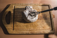 Cutting cooked meat Royalty Free Stock Images