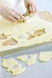 Cutting cookies from dough Stock Image
