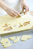 Cutting cookies from dough Royalty Free Stock Photos