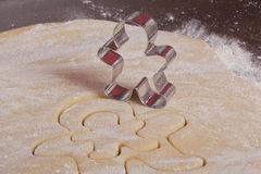 Cutting cookies dough gingerbread man Stock Photo