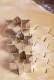 Cutting cookies dough star shape Royalty Free Stock Photo