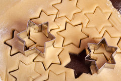 Cutting cookies dough star shape Royalty Free Stock Images