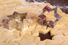 Cutting cookies dough star shape Royalty Free Stock Photos