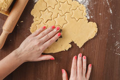 Cutting cookies dough star shape homemade for christmas Royalty Free Stock Photo