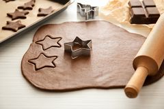 Cutting cookies from raw dough. On table Stock Images