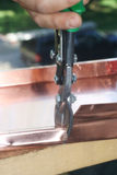 Cutting copper Stock Photo