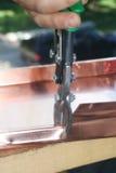 Cutting copper. Copper work Stock Photo