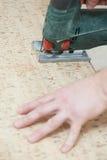 Cutting cork board with jigsaw Stock Photography