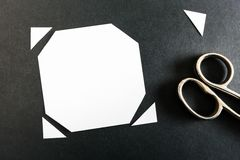 Cutting corners. A piece of paper with its corners cut off as a visualisation of the phrase cutting corners Royalty Free Stock Photography