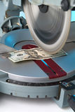 Cutting Costs. Money on miter saw stock images