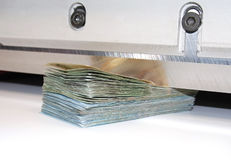 Cutting costs. Poland currency. Cutting guillotine into banknotes. Poland currency Stock Image