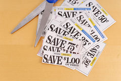 Cutting Coupons. From Magazines Or News Paper Stock Photo