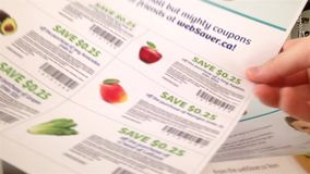 Cutting coupons stock video