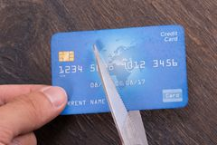 Cutting credit card. Scissors cutting old credit card. Closeup shot Royalty Free Stock Photography