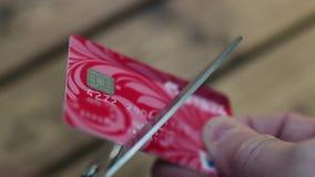 Cutting credit card scissors. Cutting up credit card with scissors close to
