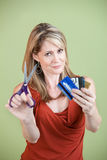 Cutting Credit Cards. Mature Caucasian women with scissors and credit cards Royalty Free Stock Images