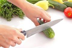 Cutting a cucumber Stock Photo