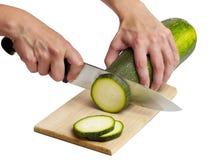 Cutting cucumber Royalty Free Stock Photos