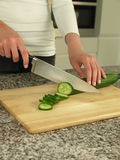 Cutting cucumber Stock Image