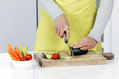 Cutting cucumber Stock Images