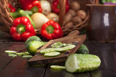 Cutting cucumber. Vegetable meal preparation Stock Image