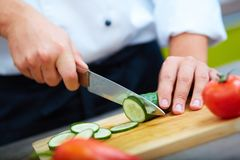 Cutting cucumbers Royalty Free Stock Photo