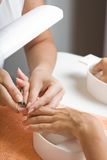 Cutting cuticle. A photo of manicure process - cuttinc cuticle royalty free stock photography